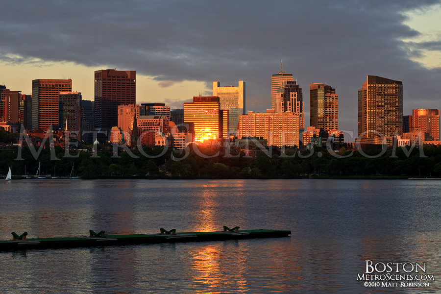 Sunset reflects behind Beacon Hill