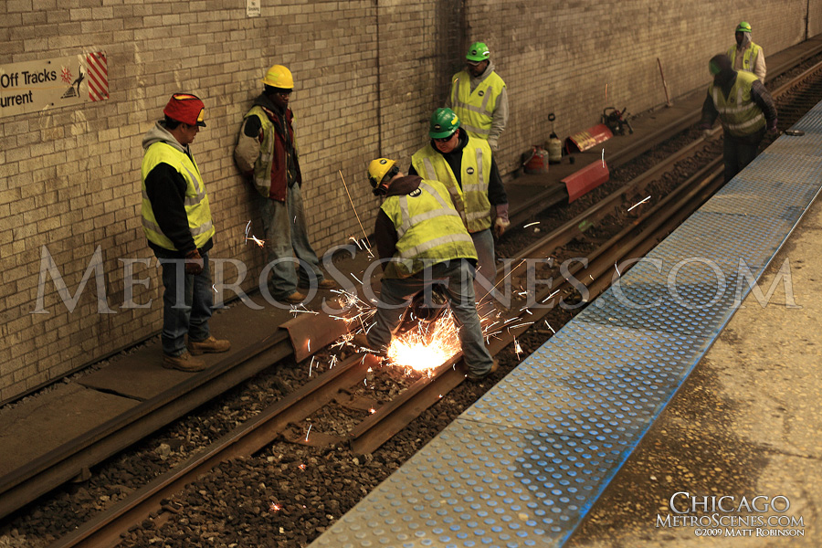 Chicago Transit Authority workers replace rail at Logan Square