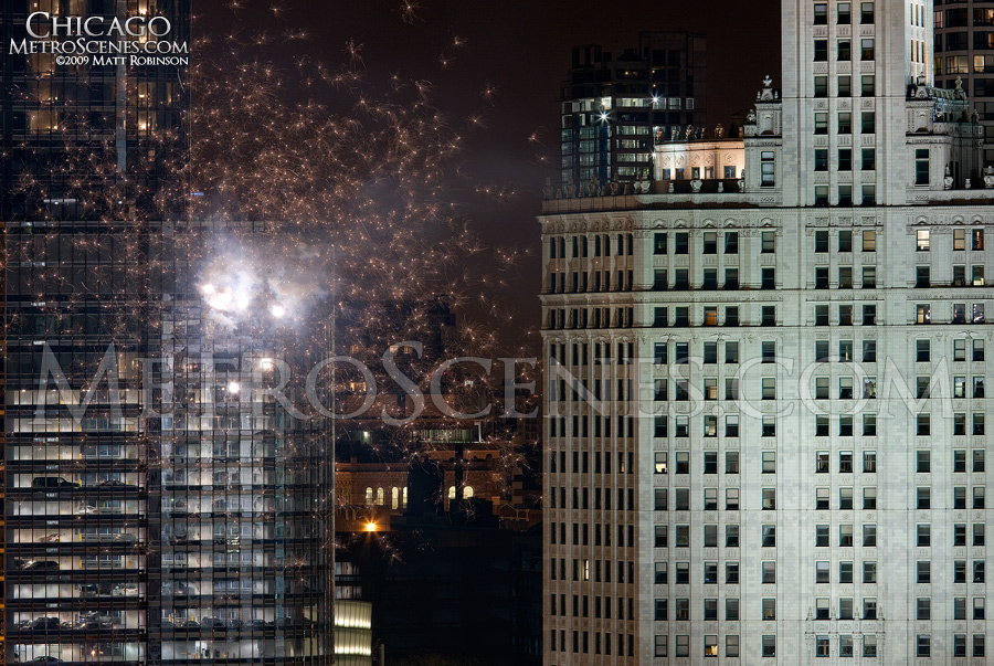 Fireworks explodes near the Wrigley Building