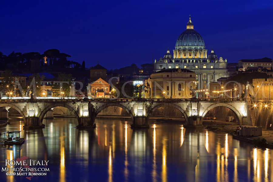 The Tiber River with the St. Peter's Basilica at night