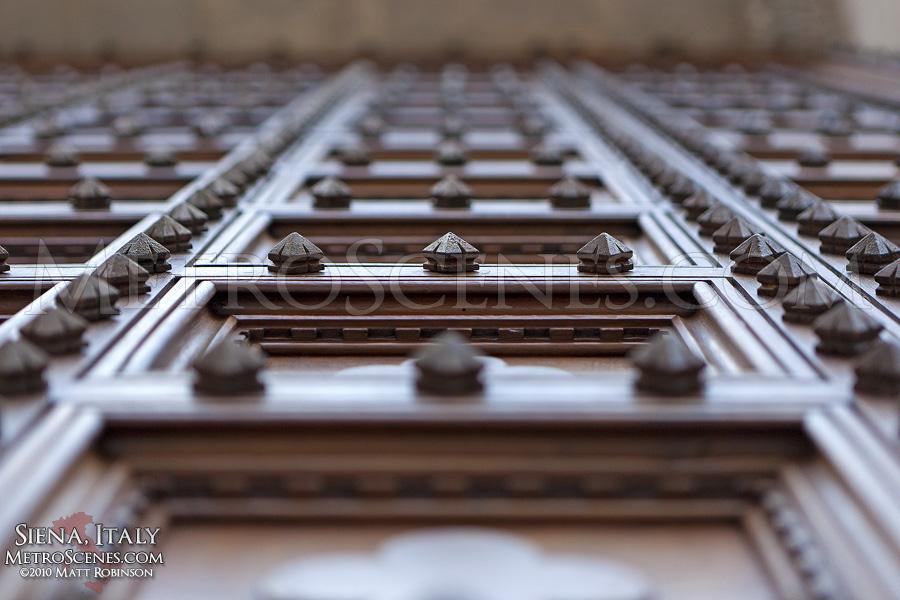 Wooden door of the Duomo in Siena