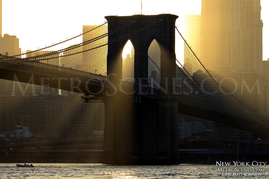 Sunbeams shine through the Brooklyn Bridge