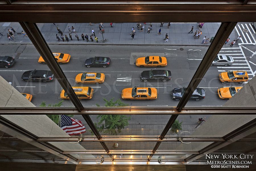 Yellow and Black vehicles on Fifth Avenue