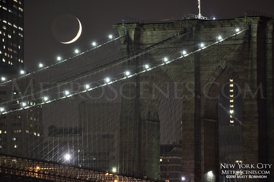 Moon set behind Brooklyn Bridge