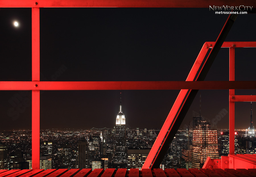The General Electric sign atop Rockefeller Center illuminates a platform that frames the Empire State Building.