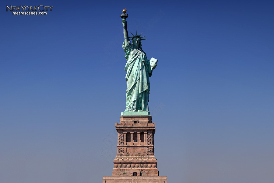 The Statue of Liberty on a blue sky.
