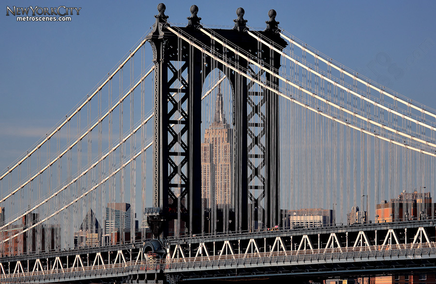 The Manhattan Bridge frames the Empire State Building, as seen from the Brooklyn Bridge.