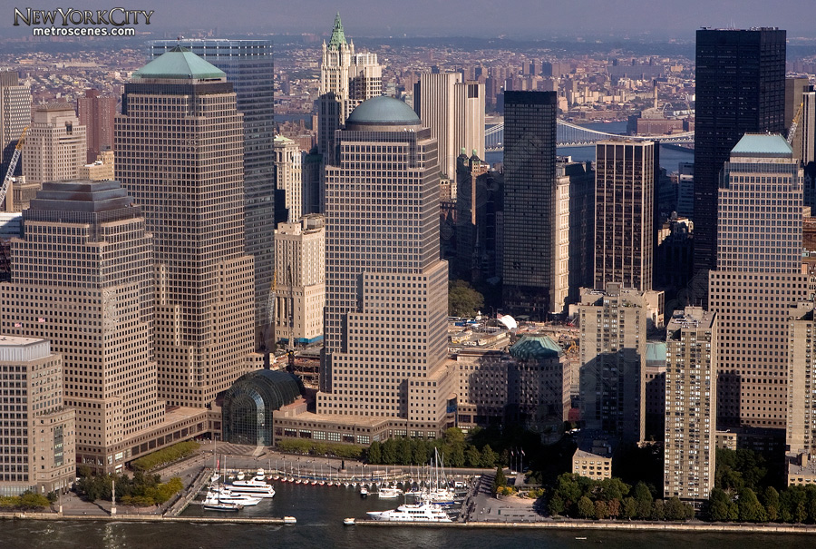 """Aerial of """"groundzero"""" and surrounding buildings seen from high above the Hudson river."""