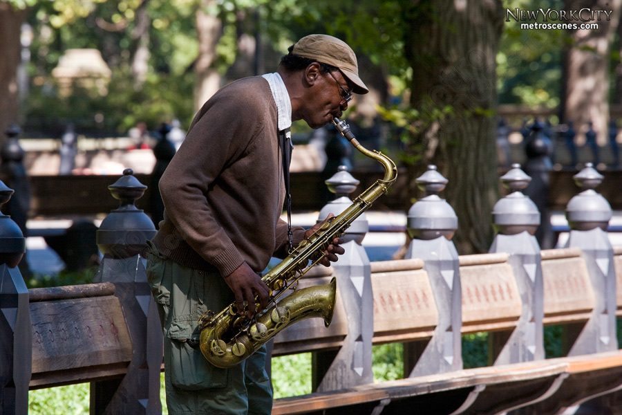 Street performer plays a saxophone in Central Park.