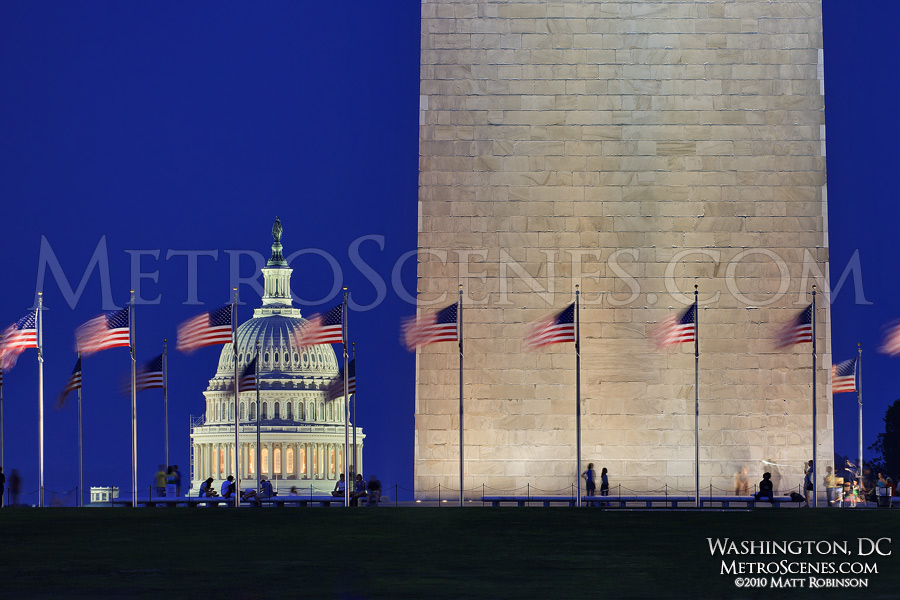 Base of the Washington Monument and US Capital dome at dusk