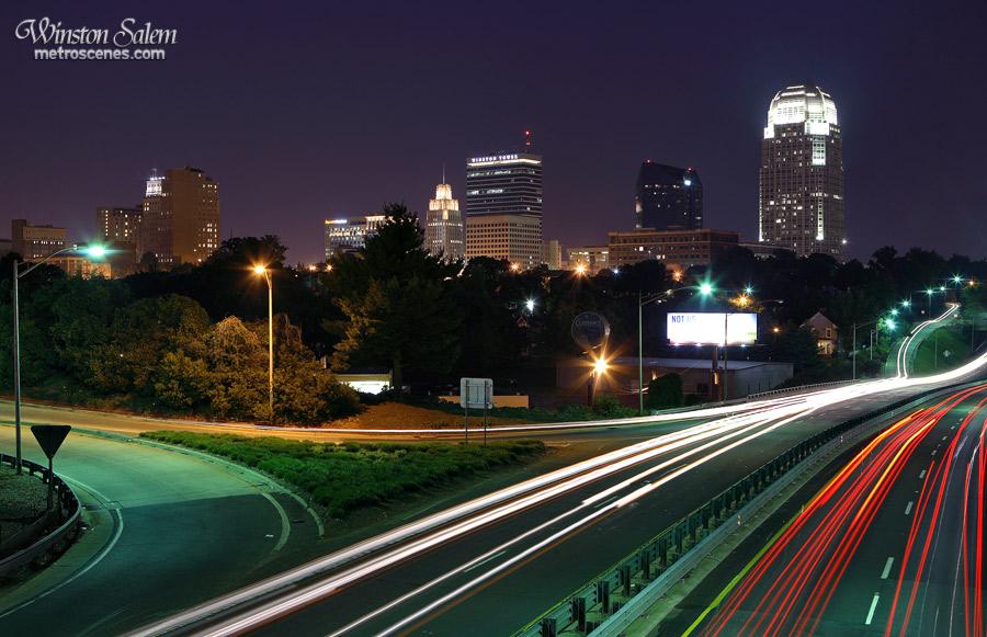Winston Salem at night with streaming traffic